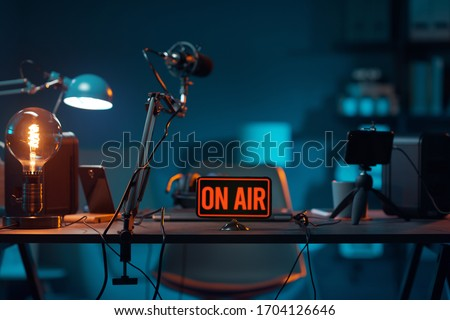 Live online radio studio desk with on air sign, entertainment and communication concept #1704126646