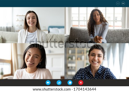 Laptop screen webcam view four multi ethnic beautiful millennial women involved in group video call. Meeting of friends on-line, colleagues working distantly, virtual communication modern tech concept #1704143644