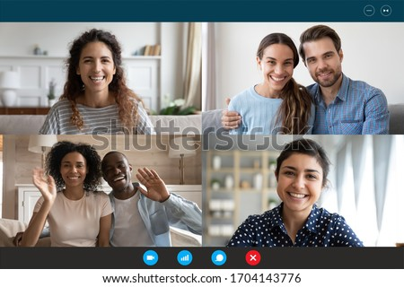 Laptop webcam screen view multiethnic families contacting distantly by videoconference. Living abroad four diverse friends making video call enjoy communication, virtual interaction modern app concept Royalty-Free Stock Photo #1704143776