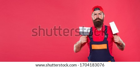 Successful renovation. Repair success. Bearded man worker with plastering tools. Plasterer hipster builder in cap red background. Interior designer. Professional plasterer. Skillful plasterer. #1704183076