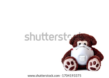 Save the children. A cute bear wearing a respirator mask, with clear white background for a webseite or poster with space for text. Panic and fear related to the outbreak of the COVID-19 coronavirus.