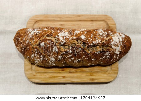 fresh bread on linen,bread lies on a cutting board,baked bread lies on the table,sliced ​​bread on linen background,home baked loaf,home made bread #1704196657