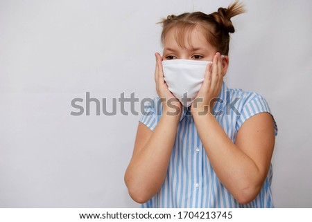 Protection from infectious diseases, coronavirus. White girl wearing a hygiene mask to prevent infection, airborne respiratory disease such as flu, closed Studio shot isolated on a white background #1704213745