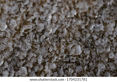 Frozen dew, frosty crystal ice frost picture of frozen icy wooden surface structure very detailed macro closeup view