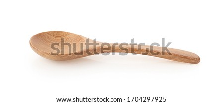 Wooden spoon isolated on a white background, photography  Royalty-Free Stock Photo #1704297925