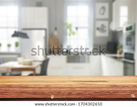 Wood table top on blur kitchen counter (room)background.For montage product display or design key visual layout. #1704302650