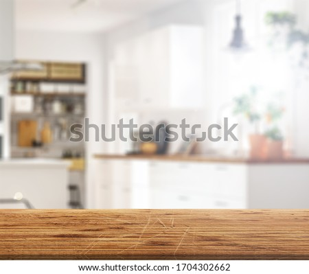 Wood table top on blur kitchen counter (room)background.For montage product display or design key visual layout. #1704302662