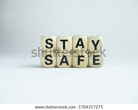 """Stay safe concept. Word """"Stay Safe"""" isolated on white background. Stay at home, social media campaign for covid-19 or coronavirus pandemic prevention. Royalty-Free Stock Photo #1704317275"""