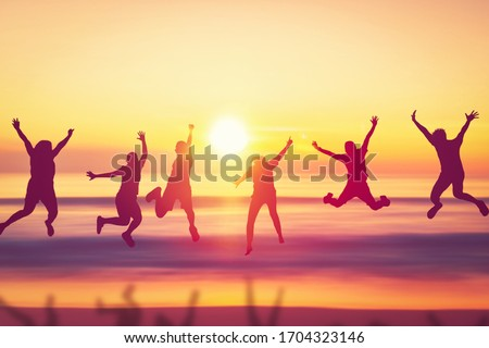 Happy friend jumping at tropical sunset beach background. Copy space of friendship freedom vacation and travel holiday teamwork concept. Vintage tone filter effect color style. #1704323146