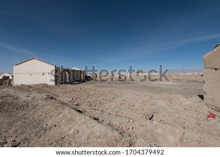 view of the ruins of the abandoned oil town, Lenghu, China Royalty-Free Stock Photo #1704379492
