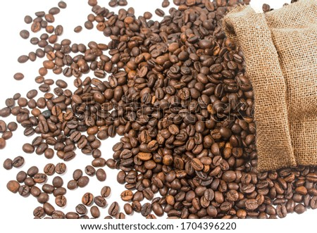 Coffee. Roasted coffee beans falling in a burlap sack. Sackcloth bag with coffee beans, isolated on white background. #1704396220