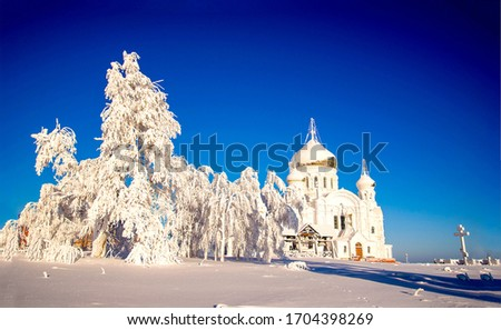 Winter snow rural church landscape. Rural winter snow covered church in Russia. Winter snow rural church #1704398269