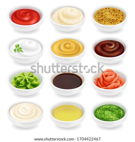 Many different sauces in round bowls set. Various ketchup mustard condiment in 3d realistic style. Side view collection. Textured pesto tartar spices isolated on white background. Oil, mayonnaise and Royalty-Free Stock Photo #1704422467