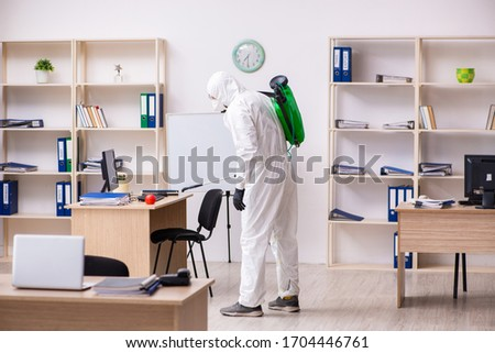 Contractor disinfecting office for COVID-19 coronavirus #1704446761