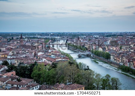 VERONA/ITALY - 3 APRIL 2017: View of the evening Verona from the observation deck at the Castle of St. Peter. Verona, Veneto, Italy #1704450271