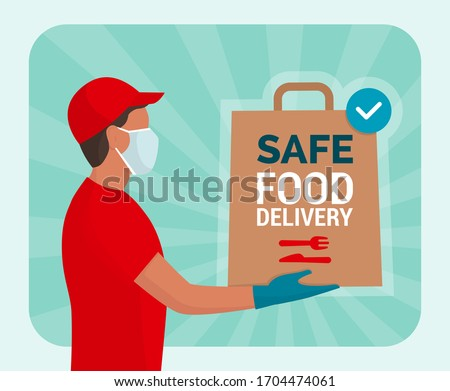 Safe food delivery at home during coronavirus covid-19 epidemic: delivery man holding a bag with fast food, he is wearing a face mask and gloves #1704474061