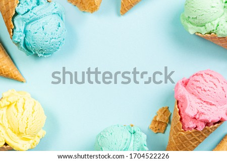 Pastel ice cream in waffle cones, bright background, copy space #1704522226