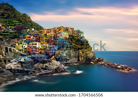 Beautiful landscape of a coastal fishing village, amazing view on many little colorful houses, traditional architecture of the little Italian town called Cinque Terre #1704566506