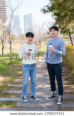 a young man who drinks coffee and talks affectionately #1704575551