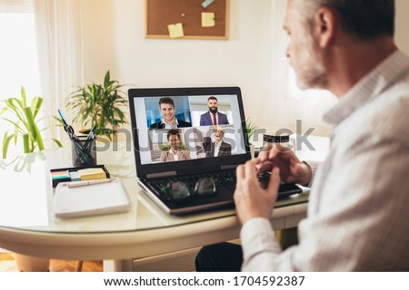 Man working from home having online group videoconference on laptop #1704592387