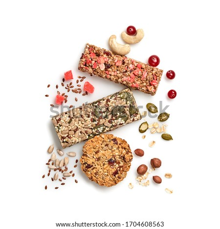 Granola bar with nuts and dry fruit berries. Cereal healthy snack. Fitness food. Protein muesli bars isolated on white background. Sport oatmeal bar, top view Royalty-Free Stock Photo #1704608563