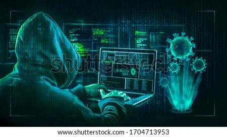 hacker virus malware  attack  during coronavirus pandemic  concept #1704713953