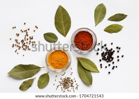 set of assorty colorful spices and herbs in bowls on white background, flat lay, top view #1704721543