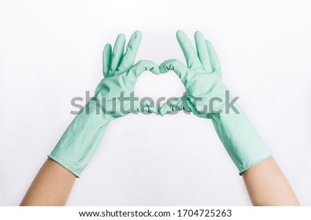 hands in latex rubber mint gloves cleaning quarantine covid-19 #1704725263