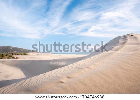 Sand dunes in the wind at Patara beach, Antalya province, Turkey Royalty-Free Stock Photo #1704746938