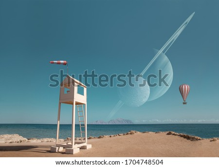 Abstract surreal picture with strange building on the sea shore with flying balloon and the planets in the clear sky.
