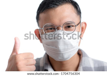 Asian man wearing the face mask against Coronavirus disease (COVID-19). #1704756304
