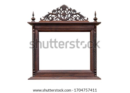 antique picture frame with wood carving style Thai pattern art isolated on white background,clipping path #1704757411