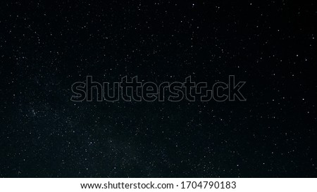 Starry night sky as a background. Dark interstellar space.