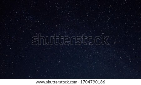 Starry night sky as a background. Dark interstellar space. #1704790186
