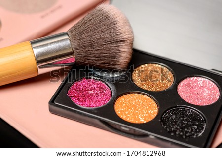 Color palette of eye shadows and brushes for professional make-up artist on a black background #1704812968