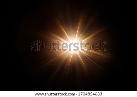 Easy to add lens flare effects for overlay designs or screen blending mode to make high-quality images. Abstract sun burst, digital flare, iridescent glare over black background. #1704854683