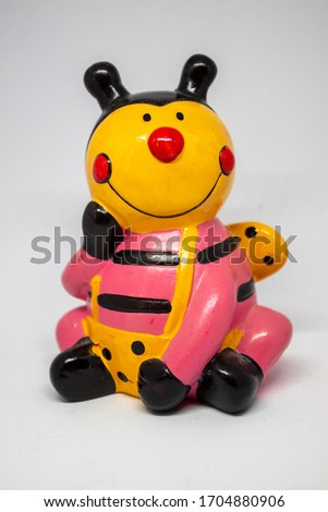 Happy ladybug ornament, stock picture