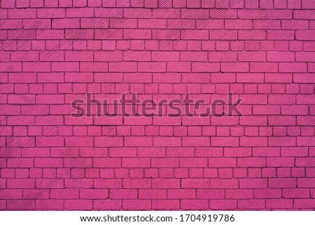Pink painted brick wall with dots background. #1704919786