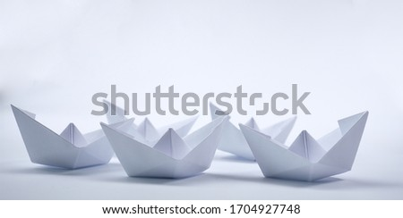 paper boats on the white background #1704927748