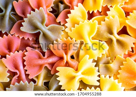 Colorful italian pasta farfalle tricolore abstract background. Traditional food. Texture. #1704955288