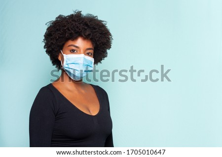 young black model wearing protective mask and black shirt and black power hair #1705010647