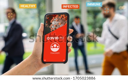 coronavirus tracking app on a mobile smartphone. Close up of woman tracking crowd of people in a smartphone screen application. Hand holding smart device. Mockup website. covid-19 corona virus tracker #1705023886