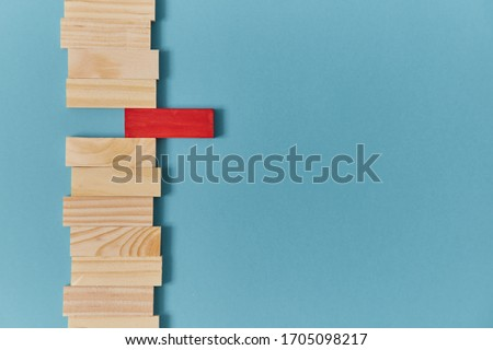 Stand out from crowd mockup. Not like everyone. White crow. Uniqueness and originality. Wooden planks with red block Royalty-Free Stock Photo #1705098217