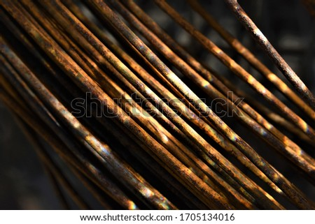 Metallic wire with rust on the surface. #1705134016