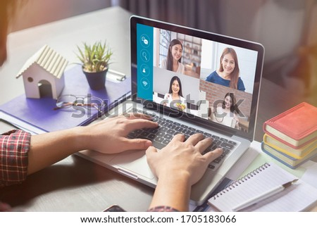 businesswoman talking colleagues about plan life in video conference. Multiethnic business team laptop online meeting in video call.smart working from home, quarantine from coronavirus covid-19 #1705183066