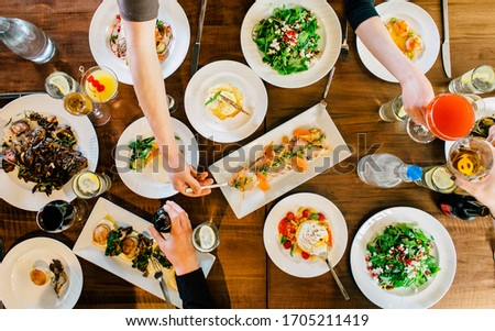 Big Dinner Table of People Eating Drinking Together #1705211419