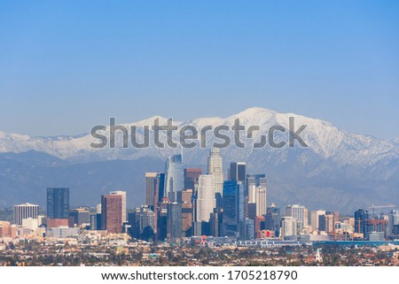 Downtown Los Angeles Skyline with Snow-capped Mountains - Panorama