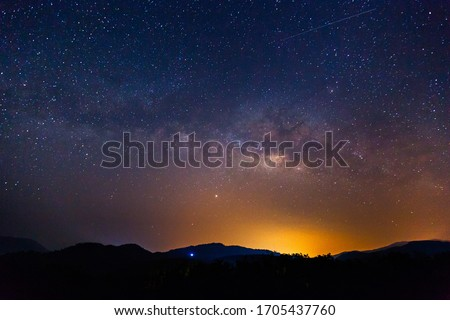 Amazing galaxy with the milky way and golden bright light before sunrise, The starry in the night sky are visible from earth