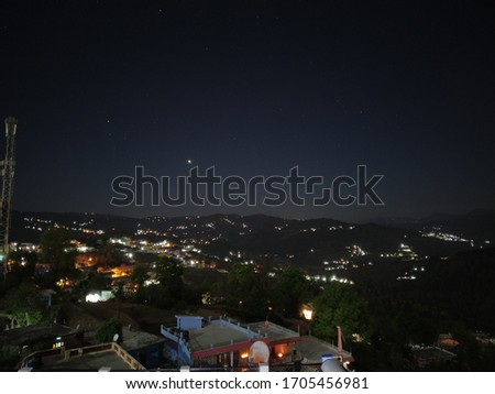 beautiful scene captured from hills of Almora at night. The planet venus can be seen in the picture.