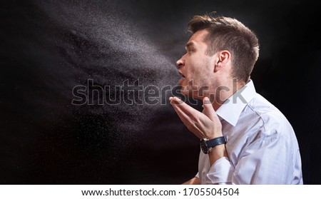 Man is coughing trying to cover his mouth.  Influenza, cold, flu, coronavirus. Infection through an airborne droplet. Droplets of saliva, water and viruses. Cough and sneeze. Man 30-40 aged Royalty-Free Stock Photo #1705504504